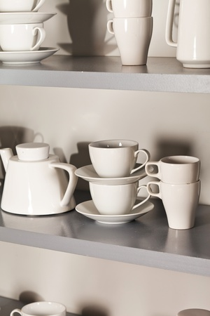 white cups on the shelf photo