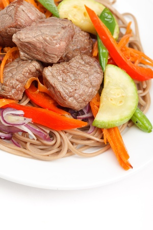 meat with vegetables and noodles photo
