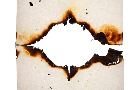 Burn hole in  paper  photo