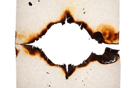 burnt edges: Burn hole in  paper  Stock Photo