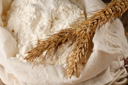 Whole flour with wheat ears  photo