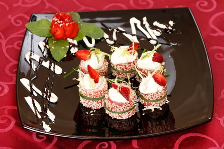 Tiramisu Sushi Roll garnished with Strawberry and Mint  photo