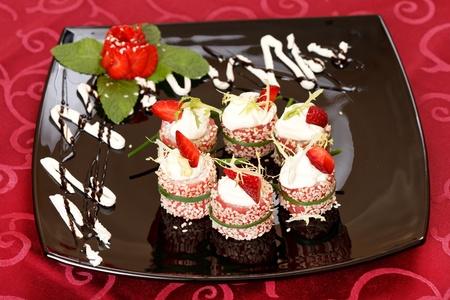 tiramisu: Tiramisu Sushi Roll garnished with Strawberry and Mint