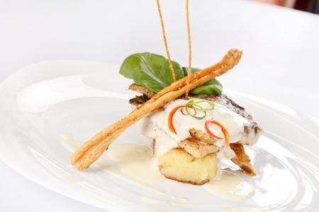 Carp fillet on roasted potatoes  photo