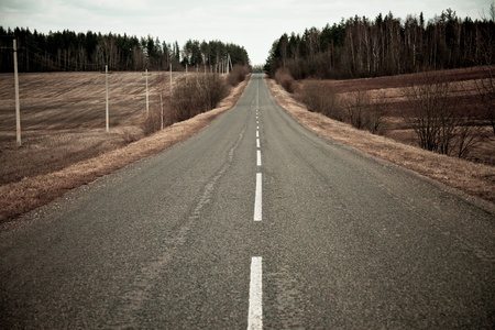 road in middle of rural area photo