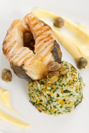 tilapiini: fish steak with rice