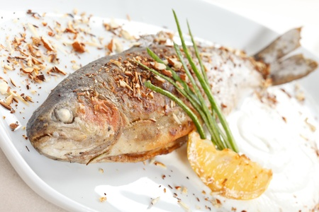 trout fishing: trout fish baked with nuts Stock Photo