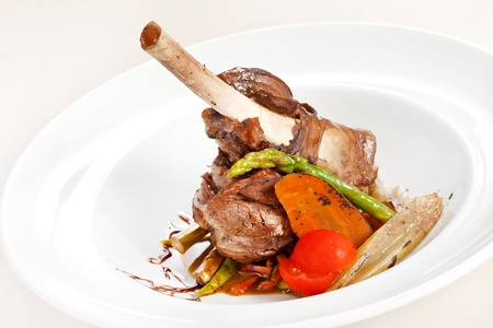 lamb chops on a bed of vegetables  photo