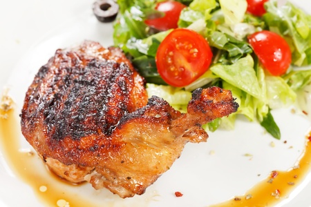Roasted chicken leg with salad Stock Photo - 10422505