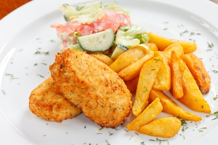 chicken cutlet with fried potatoes photo