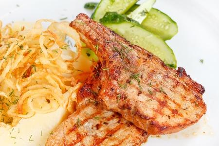 salmon steak with potatoes photo