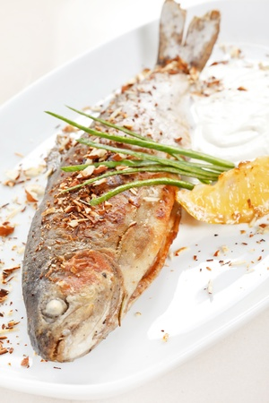 rainbow fish: trout fish baked with nuts Stock Photo