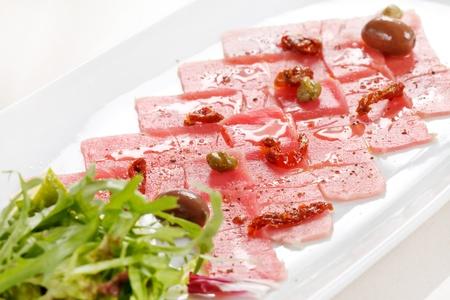 carpaccio: Fish Carpaccio with olives ana salad Stock Photo