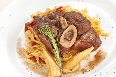 tasty steak with pasta  photo