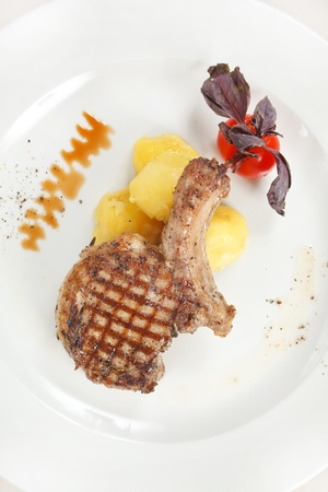 steak served with potatoes photo