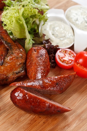 sausages on a wooden cutting board  photo