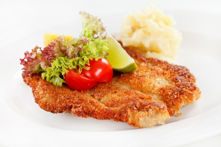 breaded: schnitzel with potatoes