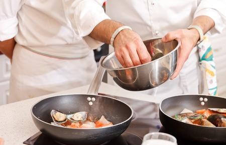 italian chef: chef at work Stock Photo
