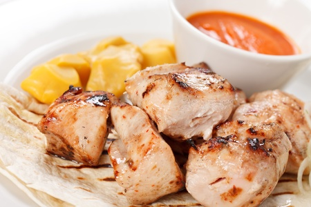 chicken with tortilla and sauce photo