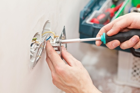 The hands of an electrician
