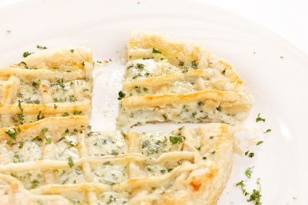 tasty quiche with cheese and herbs photo