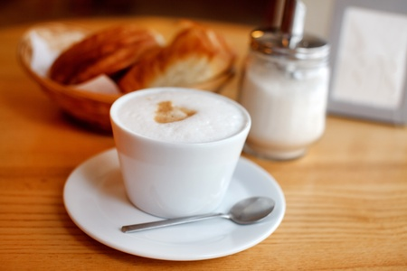 Cup of coffee with croissants Stock Photo - 12149362