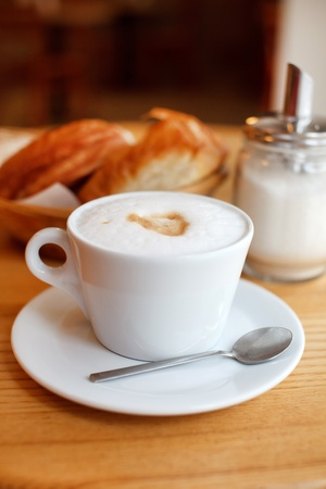 Cup of coffee with croissants photo