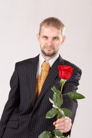 man with red roses photo
