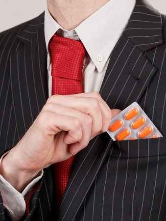 man holding pills photo