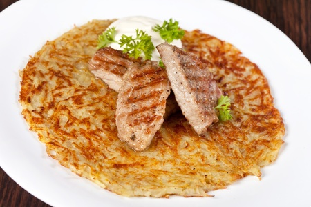 potato pancake with meat photo