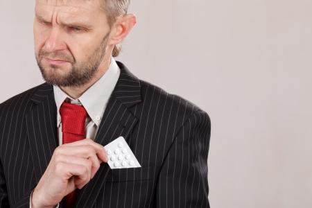 man holding pills photo