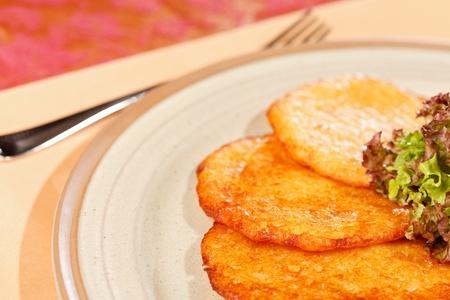 potato pancakes with sausages photo