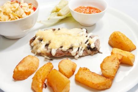 Schnitzel with potatoes photo