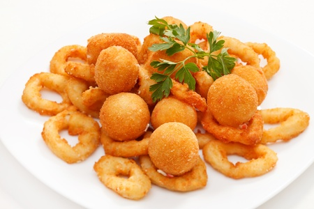 fried onion rings and cheese balls photo