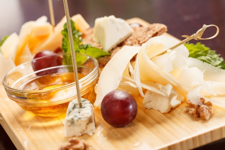 Cheese plate with grapes and honey  photo
