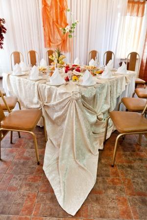 gold table cloth: Wedding table setting