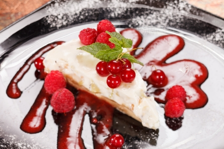 cheesecake with red currant and mint photo
