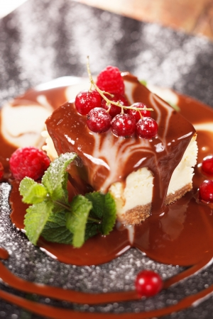 Chocolate cheesecake with berries photo