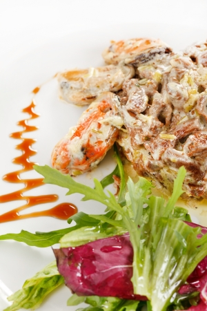 fricassee: Fricassee with seafood and salad