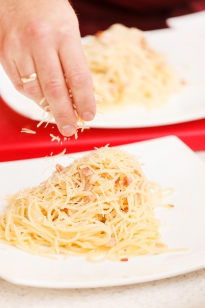 Chef preparing pasta photo