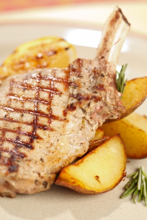 Grilled meat ribs with potatoes photo