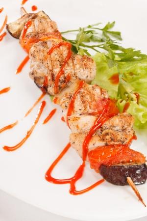 Chicken kebab with tomato sauce photo