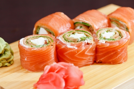 person appetizer: tasty sushi Stock Photo