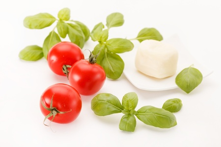 cherry tomatoes: tomatoes and basil Stock Photo