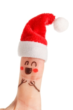 santaclaus: Finger dressed in Santa-Claus red-white hats