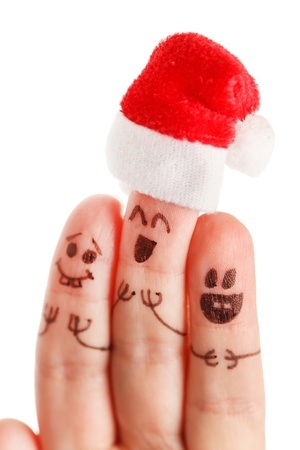 Fingers dressed in Santa-Claus red-white hats photo