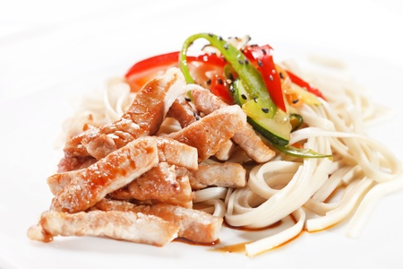 meat with noodles and vegetables  photo