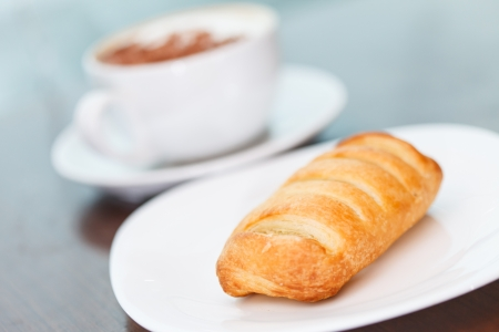 coffee with puff pastry photo