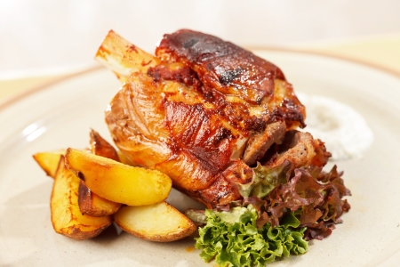 roasted pork knuckle with potatoes photo