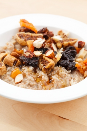 oatmeal with raisins, nuts and maple syrup photo